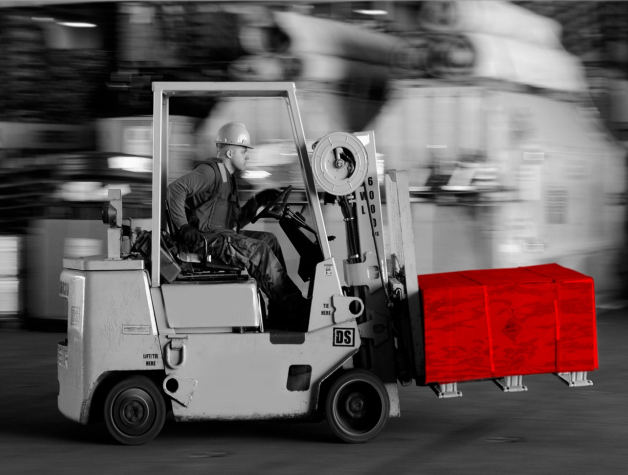 man on the forklift carryting industral packaging crates